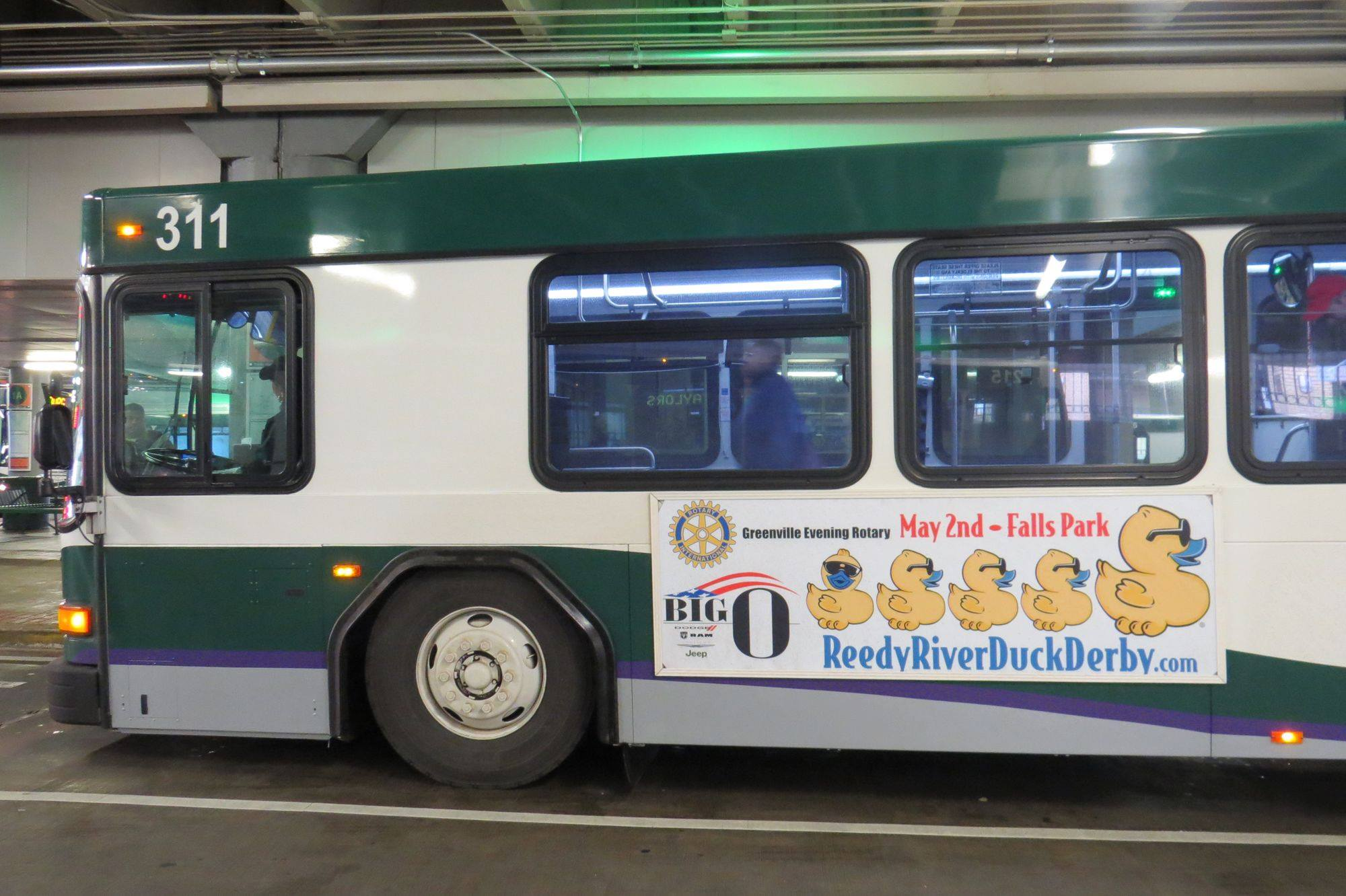Duck Race Banner on a City Bus